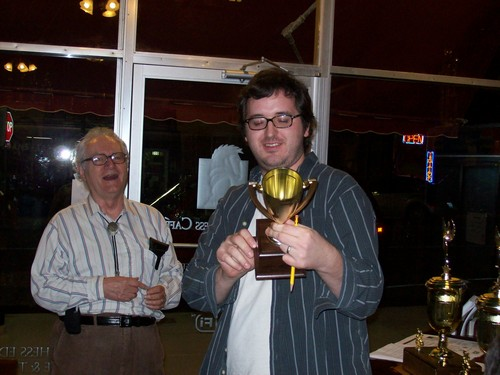Chris Morgan receives an Under 1200-Unrated Champion Trophy
