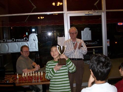 Hanson Hao receives a Scholastic Champion Trophy
