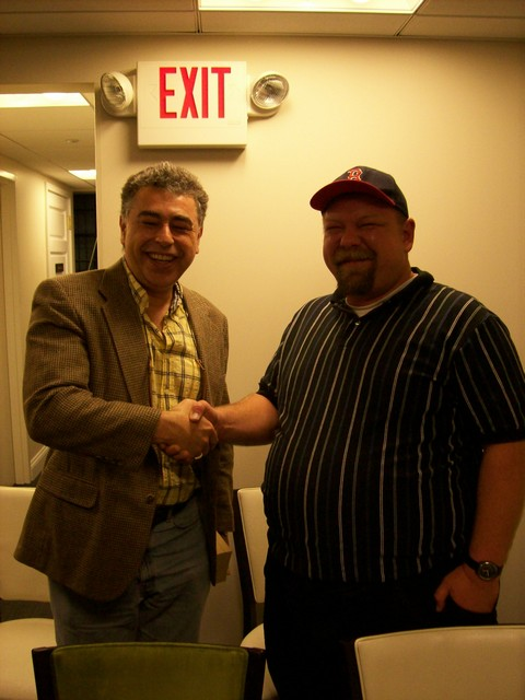 Darren Erickson gets to shake hands with GM Yasser Seirawan