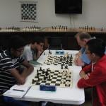 Round 1, Top 2 boards.  (Clockwise from top right, Joseph Alford, Jason Chien, Karthik Karra, Mihir Bafna)