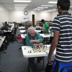 Round 2, Dennis Bourgerie (sitting,) Karthik Karra (standing)